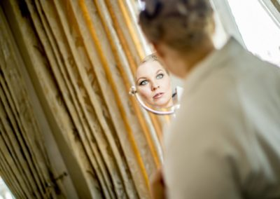 Before the ceremony: With just 30 minutes to go, the Bride checks her makeup.