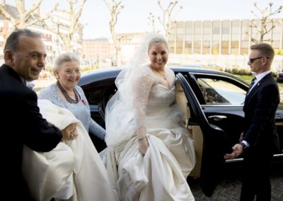 Before the ceremony: The bride arrives at the church. From the left – Karim Feyzi (dress designer), the mother of the Bride, the bride & Thomas, the driver.