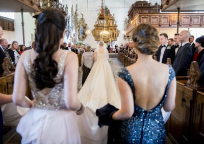 The Wedding Ceremony: The Bride and her following walking down the aisle.