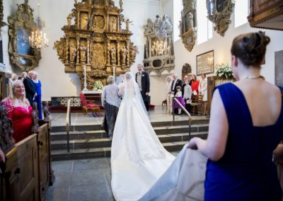 The Wedding Ceremony: The Bride and her following arriving at the altar.