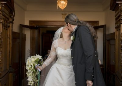 The Wedding Ceremony: The newly wed couple after the ceremony – kissing while exiting the church.