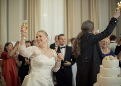 The Reception: The newly wed couple toasts with all the guests.