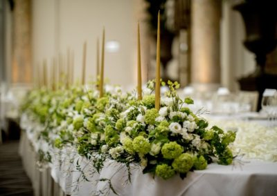 Preparing for the Dinner: The main table. The all-white flower theme throughout the wedding was by d'Angleterre at the establishment and by Bering in the bouquet and church decorations.
